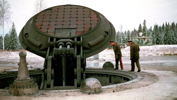 Russian high ranking military officials, look into an opened silo of a Russian intercontinental ballistic Topol-M missile somewhere at undisclosed location in Russia in this 2001 photo - Sputnik France