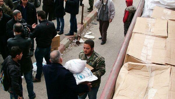 Distribution d'aide humanitaire russe dans la province syrienne de Lattaquié - Sputnik France
