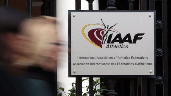 A woman walks past the IAAF (The International Association of Athletics Federations) headquarters in Monaco November 4, 2015 - Sputnik France