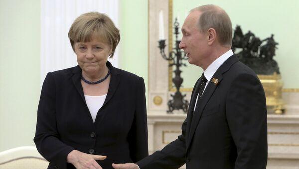 Angela Merkel et Vladimir Poutine - Sputnik France
