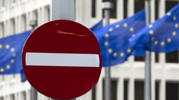 EU flags flutter in the wind in back of a no entry street sign in front of EU headquarters in Brussels on Friday, June 24, 2016. - Sputnik France