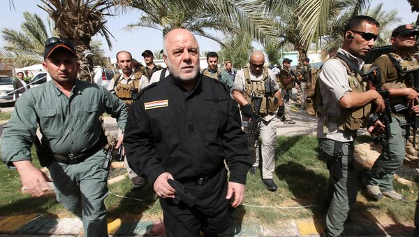 Iraq's Prime Minister Haider al-Abadi (front 2nd L) walks during his visit to an Iraqi army base in Camp Tariq near Falluja, Iraq, June 1, 2016. - Sputnik France