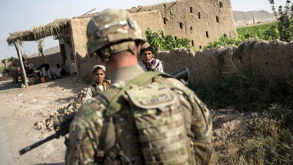 Un soldat américain près de l'aérodrome de Kandahar le 3 juin, 2014 - Sputnik France