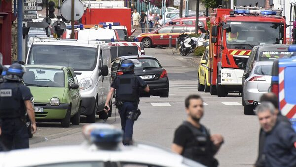 Police and rescue workers stand at the scene after two assailants had taken five people hostage in the church at Saint-Etienne-du -Rouvray near Rouen in Normandy, France, July 26, 2016. - Sputnik France