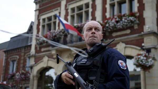 A policeman secures a position in front of the city hall after two assailants had taken five people hostage in the church at Saint-Etienne-du -Rouvray near Rouen in Normandy, France, July 26, 2016 - Sputnik France
