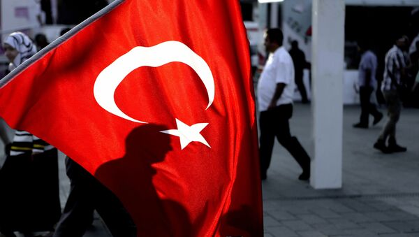 A man's shadow is seen behind a Turkish flag at Taksim square in Istanbul, on Saturday, July 30, 2016. - Sputnik France