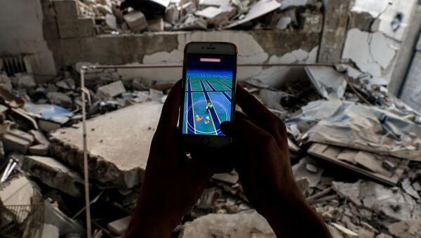 Des enfants syriens jouent à Pokémon Go pour échapper à la réalité d'Alep - Sputnik France