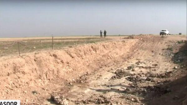 Plus de 70 charniers de Daech découvertes en Syrie et en Irak - Sputnik France