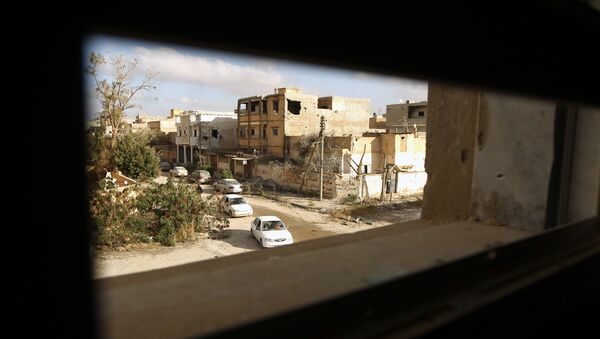 Cars drive down a road after fighters loyal to Libya's internationally recognised government seized the centre of the eastern coastal city of Benghazi on February 25, 2016 - Sputnik France