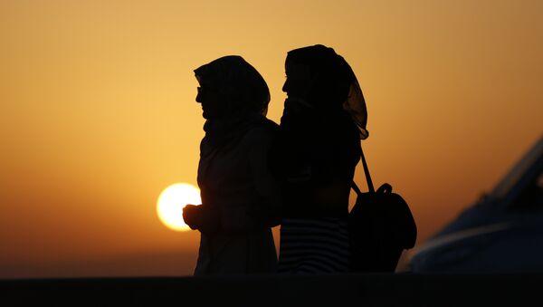 Deux femmes musulmanes. Image d'illustration - Sputnik France