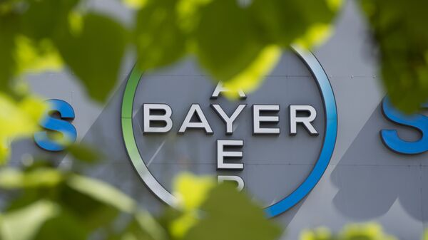 This file photo taken on July 24, 2013 shows a logo of German pharmaceuticals and chemicals giant Bayer on an overpass at its Berlin headquarters - Sputnik France
