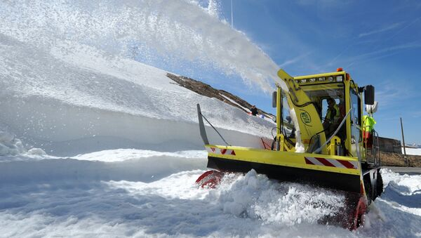 A snowplow is in action, on May 28, 2015 at the Little St Bernard Pass near the French Italian border in Seez, as part of the works to open the road to traffic. - Sputnik France