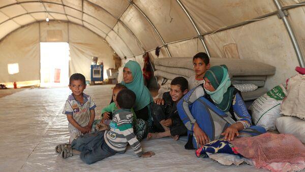 Réfugiés ayant fui Mossoul - Sputnik France