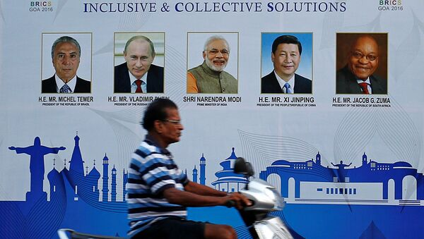 A man rides past a billboard near one of the venues of BRICS (Brazil, Russia, India, China and South Africa) Summit in Benaulim, in the western state of Goa, India October 14, 2016. - Sputnik France