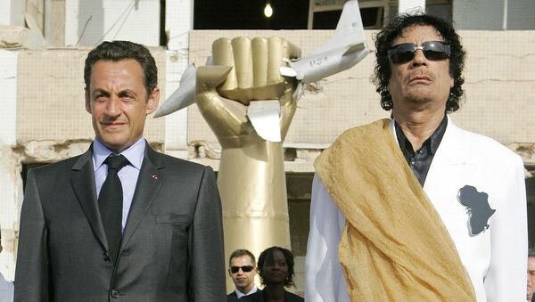This July 25, 2007 file photo shows Libyan leader Moammar Gadhafi, right, and French President Nicolas Sarkozy standing while national anthems are being played, at the Bab Azizia Palace in Tripoli, Libya - Sputnik France