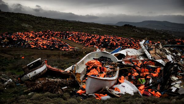 Wrecked boats and thousands of life jackets used by refugees and migrants during their journey across the Aegean sea lie in a dump in Mithimna on February 19, 2016. - Sputnik France