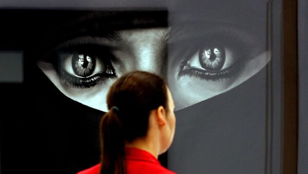 A woman looks at the work Burka by US artist Robert Longo at the booth of the gallery Hans Mayer on April 12, 2011 at the Art Cologne art fair in Cologne, western Germany. Around 200 international galleries will be showcasing Classic Modernism, Post-War and Contemporary art during the fair running until April 17, 2011. - Sputnik France
