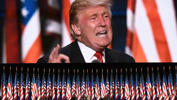 This file photo taken on July 21, 2016 shows US Republican presidential candidate Donald Trump speaks on the last day of the Republican National Convention in Cleveland, Ohio. Donald Trump said on November 9, 2016 he would bind the nation's deep wounds and be a president for all Americans, as he praised his defeated rival Hillary Clinton. - Sputnik France