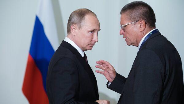 Vladimir Poutine et Alekseï Oulioukaïev - Sputnik France