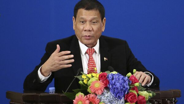 Philippine President Rodrigo Duterte delivers a speech during the Philippines-China Trade and Investment Forum at the Great Hall of the People in Beijing - Sputnik France