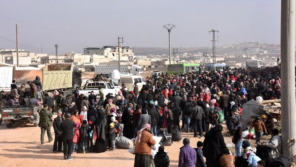 Syrians that evacuated the eastern districts of Aleppo gather to board buses, in a government held area in Aleppo, Syria in this handout picture provided by SANA on November 29, 2016. - Sputnik France