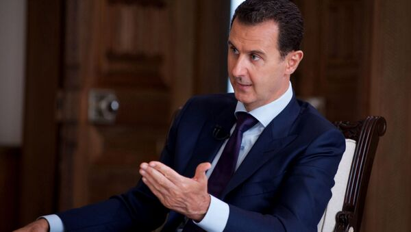 In this photo released on July 1, 2016, by the Syrian official news agency SANA, Syrian President Bashar Assad speaks during an interview with Australia's SBS news channel, in Damascus, Syria - Sputnik France