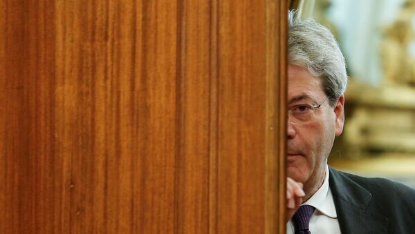 Italian Prime Minister-designate Paolo Gentiloni leaves at the end of a meeting at the Low Chamber in Rome, Italy December 12, 2016. - Sputnik France