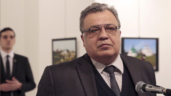 Andrei Karlov, the Russian Ambassador to Turkey, speaks at a photo exhibition in Ankara on Monday, Dec. 19, 2016, moments before a gunman opened fire on him - Sputnik France