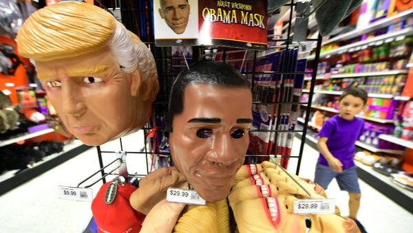 A child walks past a display of masks of US President Barack Obama, and presidential hopefuls Donald Trump and Hillary Clinton, for sale at a shop selling Halloween items in Alhambra, California on October 21, 2016 - Sputnik France