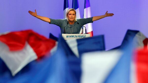 Marine Le Pen, French National Front (FN) political party leader, gestures during an FN political rally in Frejus - Sputnik France