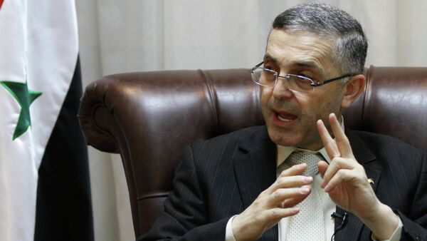 Syrian Reconciliation Minister Ali Haidar speaks during an interview with AFP in Damascus on February 11, 2014 - Sputnik France