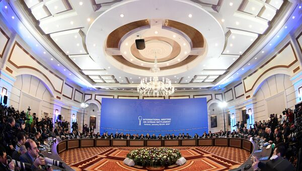 Representatives of the Syria regime and rebel groups along with other attendees take part in the first session of Syria peace talks at Astana's Rixos President Hotel on January 23, 2017. Kirill KUDRYAVTSEV / AFP - Sputnik France