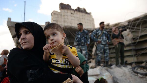 Verteilung russischer Hilfsgüter in Syrien - Sputnik France