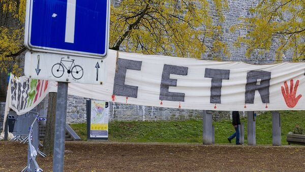 A banner against the CETA is displayed in front of the Walloon Parliament in Namur, Belgium on Friday, Oct. 28, 2016. - Sputnik France