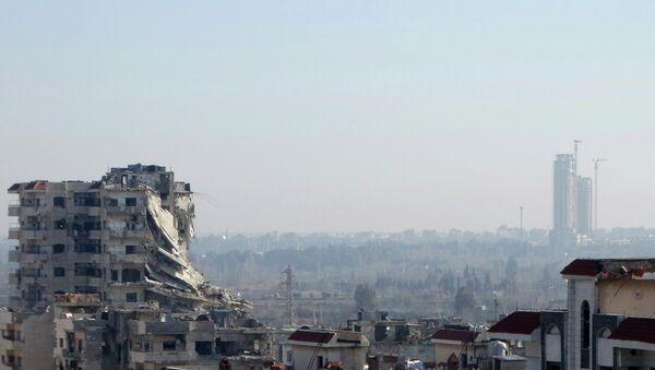 A general view shows damaged buildings in the northwestern Homs district of Al Waer January 18, 2015. - Sputnik France