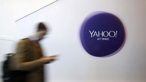 A man walks past a Yahoo logo during the Mobile World Congress in Barcelona, Spain - Sputnik France