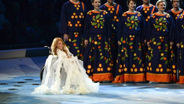 FILE In this Friday, March 7, 2014 file photo, Yulia Samoylova sits on stage during the opening ceremony of the 2014 Paralympic Games in Sochi, Russia. - Sputnik France