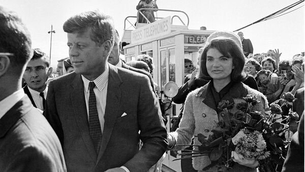 President John F. Kennedy and his wife Jacqueline Kennedy are greeted by an enthusiastic crowd upon their arrival at Dallas Airport, on November 22, 1963. Only a few hours later the president was assassinated while riding in an open-top limousine through the city. - Sputnik France