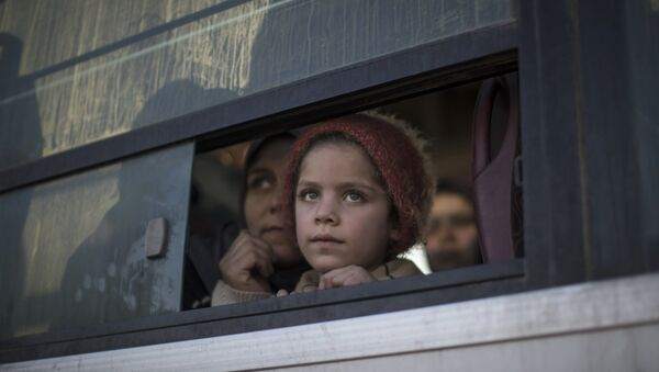 Une jeune réfugiée irakienne - Sputnik France