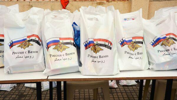 Syrie: 7,9 t d'aide humanitaire russe pour les habitants d'Alep et de Lattaquié - Sputnik France