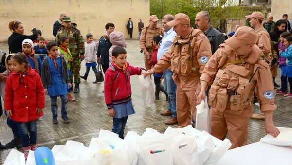Syrie: 4 t d'aide humanitaire russe pour les habitants d'Alep et de Lattaquié - Sputnik France