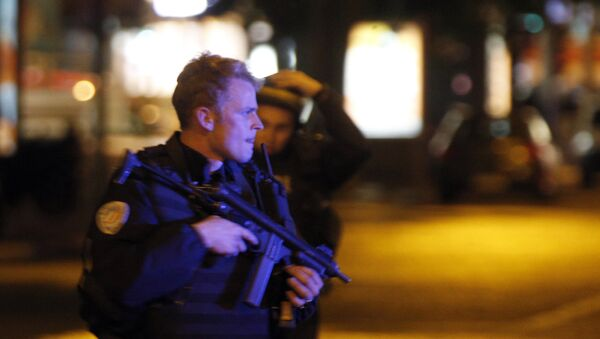 Police officers take positions on the Champs Elysees avenue in Paris, France, after a fatal shooting in which a police officer was killed along with an attacker, Thursday, April 20, 2017. - Sputnik France