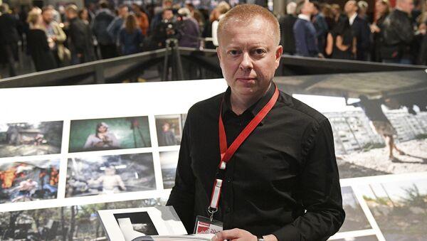 Специальный фотокорреспондент МИА Россия сегодня Валерий Мельников, победивший в конкурсе World Press Photo 2017 в номинации Долгосрочные проекты, на открытии выставки победителей World Press Photo в Амстердаме. - Sputnik France