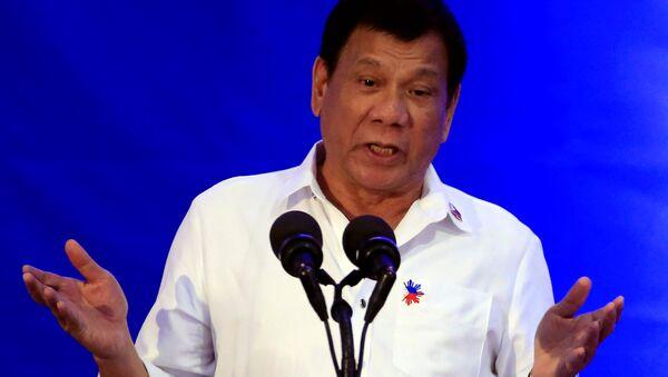 Philippine President Rodrigo Duterte gestures while delivering a speech during the 80th National Bureau of Investigation (NBI) founding anniversary at the NBI headquarters in metro Manila - Sputnik France