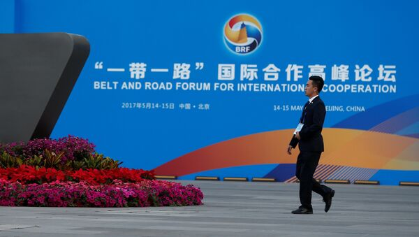 A man walks past the China National Convention Center, a venue of the upcoming Belt and Road Forum in Beijing, China, May 12, 2017. - Sputnik France