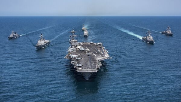 In this image released by the U.S. Navy, the aircraft carrier USS Carl Vinson, flanked by South Korean destroyers, from left, Yang Manchun and Sejong the Great, and the U.S.Navy's Wayne E. Meyer and USS Michael Murphy, transit the western Pacific Ocean Wednesday, May 3, 2017. - Sputnik France