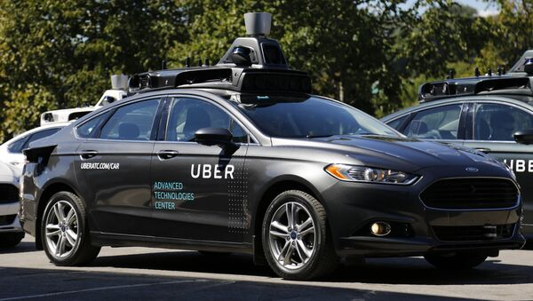 A group of self driving Uber vehicles position themselves to take journalists on rides during a media preview at Uber's Advanced Technologies Center in Pittsburgh, Monday, Sept. 12, 2016. - Sputnik France