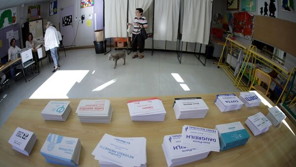 A person leaves a polling booth during the first round of French parliamentary election in Nice - Sputnik France