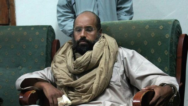 FILE - In this Saturday, Nov. 19, 2011 file photo, Seif al-Islam is seen after his capture in the custody of revolutionary fighters in Zintan. - Sputnik France