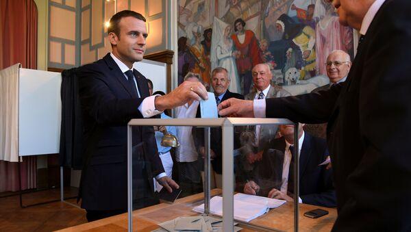 French President Emmanuel Macron casts his ballot as he votes at a polling station - Sputnik France